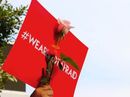 counteract: Flower and red leaflet printed with a hashtag letter to invite peoples to not afraid.