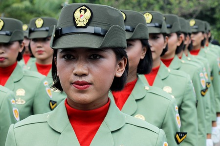 Jakarta, Indonesia - August 17, 2016: Indonesian military womens army corps marching in independence day flag ceremonial at Indonesian Presidential Palace.