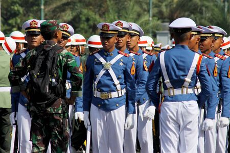 Jakarta, Indonesia - August 17, 2016: Indonesian military army cadets in preparations for the independence day flag ceremonial at Indonesian Presidential Palace. Editorial