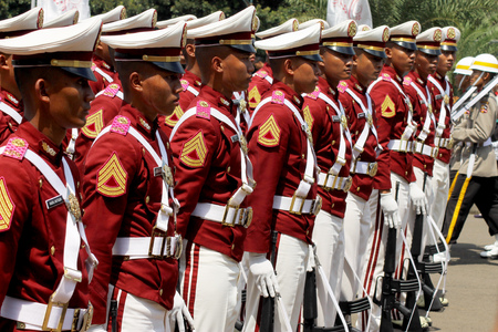 Jakarta, Indonesia - August 17, 2016: Indonesian police cadets marching with rifle in independence day flag ceremonial at Indonesian Presidential Palace.