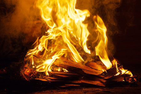smolder: Piles of scrap wood waste are burning on fire.