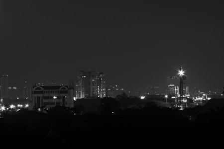 View of downtown Jakarta at night that shot from the high place in suburb area. Black and white photography.