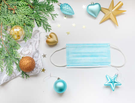 Christmas footage made of new year decorations and fir branches and face mask on a white background