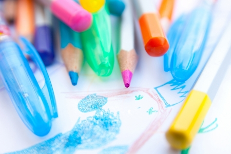 colored pencils and childs drawing Stock Photo