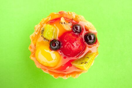 tart with different fruits and berries in jelly
