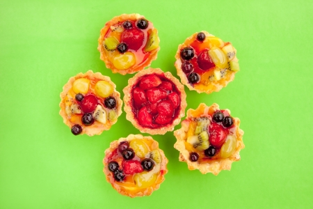 tarts with strawberry and other fruits and berries in jelly