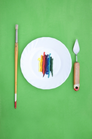 oil paint served like a dish with painting instruments Stock Photo