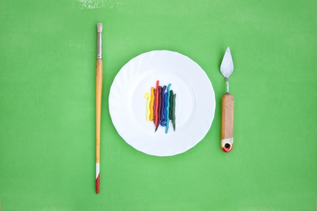 oil paint served like a dish with painting instruments Stock Photo - 20339156