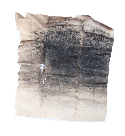 Old piece of paper with charcoal dust isolated on white  Stock Photo