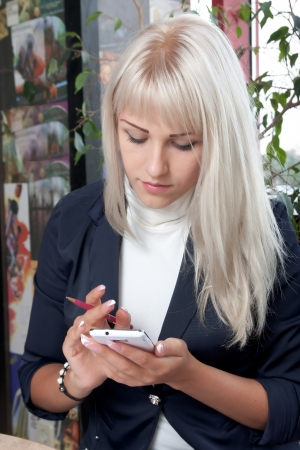 young business woman working with smartphone in cafe Stock Photo