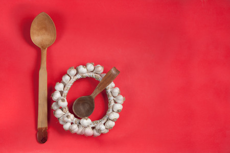 Ukrainian traditional wattled garlic round with handmade wood spoons Stock Photo