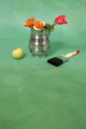 Card with roses, apple and a brush on a green  Stock Photo