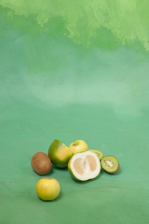 card with oroblanco and other green fruits on a green