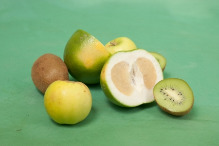 Still-life with oroblanco and other green fruits on a green  Stock Photo - 22844642