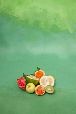 card with roses and fruits on a green  Stock Photo - 22844644