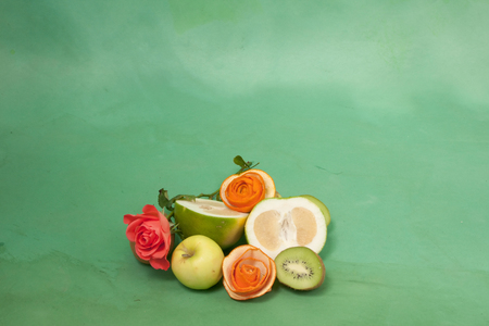 card with roses and fruits on a green Stock Photo - 22844645