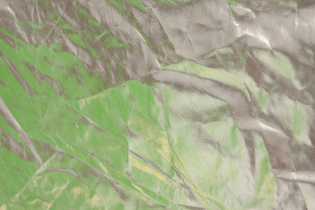 metalized: Green and yellow background with metalized fabric