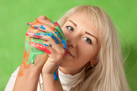 Portrait of an attractive woman with hands in fresh paint Stock Photo