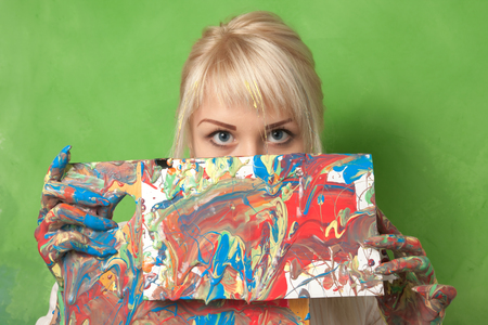 Attractive painter shows her abstract and impulsive painting