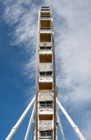 Unusual View of Observation Wheel Against the Blue Sky With Clouds, in Rimini, Italy