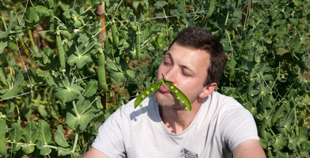 Young Handsome Man with a Cracked Pea Pod Like a Mustaches