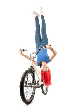 Girl that makes an incredible trick balancing upsidedown on the bmx