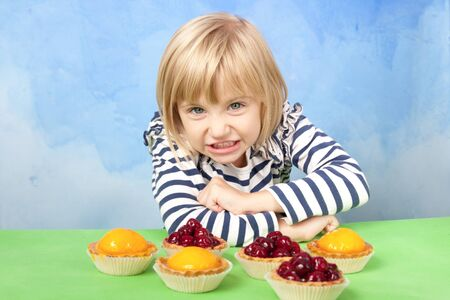 Little angry girl defending her cherry and peach jelly tarts