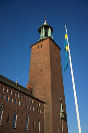 stockholm: Stockholm city hall with swedish national flag.