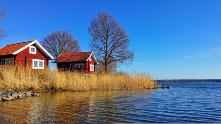 archipelago: Swedish Red House on the seaside. Color of Spring of one of Swedish Archipelago.