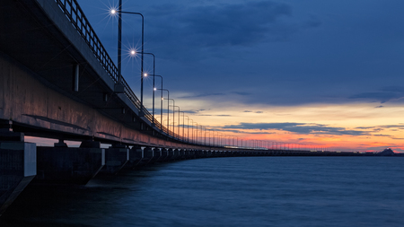 oland: Sunset at the Oland Bridge landsbron at Night, which connects land to the Kalmar, mainland of Sweden. Stock Photo