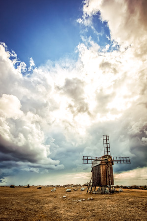 traditional windmill: After the storm, Oland, Sweden. Swedish traditional windmill under the clouds.