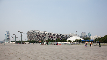 during the day: Beijing, China - Jun 20, 2016 : View of the National stadium and the Beijing Olympic Park during day time.