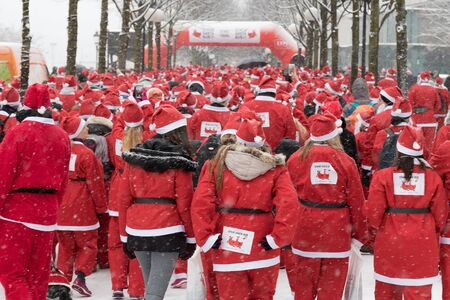 Stockholm, Sweden - Dec 11, 2016 : Stockholm Santa Run, a non competitive charity run for everyone, 2016 at Kungstradgarden Park, Stockholm, Sweden.
