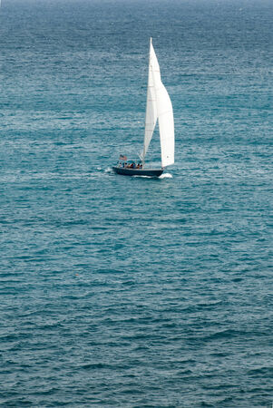 spinnaker: A sailing yatch with masthead spinnaker races across through the Caribbean sea.