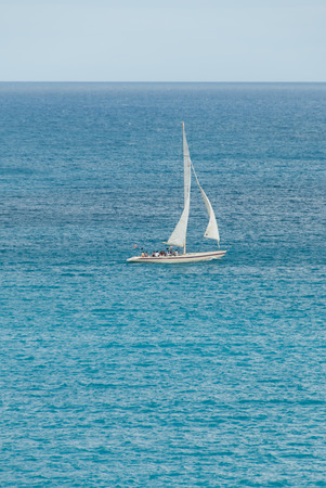 spinnaker: A sailing yatch in the caribbean with masthead spinnaker IV.