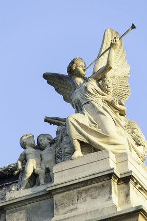 cherubs: An Angel Blowing a Horn and Cherubs at the Louvre, Paris. Stock Photo