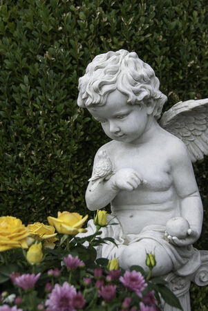 angel cemetery: Cherub and Bird Stock Photo