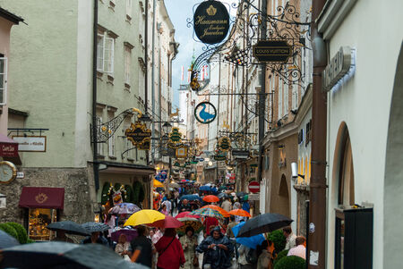 Rainy Day in Salzburg II - The busy shopping mile of the Judengasse in Salzburg, Austria on a rainy afternoon.