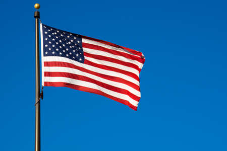 United States of America Flag against a Blue Sky photo