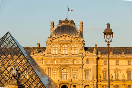 sully: Louvre, Pyramid Pavillon Sully and Louis XIV Statue in Paris, France.