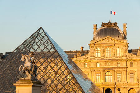 sully: Louvre, Pyramid Pavillon Sully and Louis XIV Statue II in Paris, France. Editorial