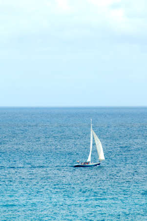 spinnaker: A sailing yatch in the caribbean with masthead spinnaker.