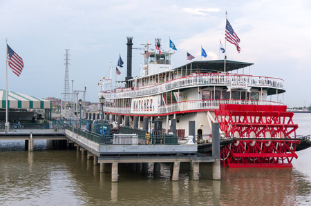 paddle wheel: New Orleans - July 13: Steamboat Natchez before its daily cruise up the Mississippi River on July 13th, 2011. The Natchez is the last authentic steamboat in operation on the river.