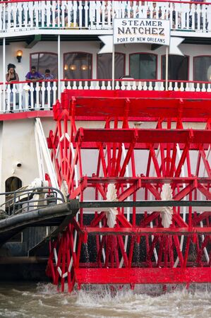 paddle wheel: New Orleans - July 13: Steamboat Natchez prepares for its daily cruise up the Mississippi River on July 13th, 2011. The Natchez is the last authentic steamboat in operation on the river.