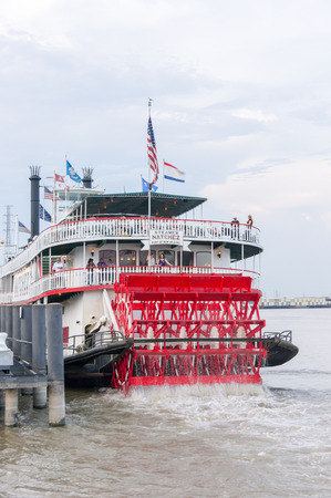 paddle wheel: New Orleans - July 13: Steamboat Natchez departs on its daily cruise up the Mississippi River II on July 13th, 2011. The Natchez is the last authentic steamboat in operation on the river.