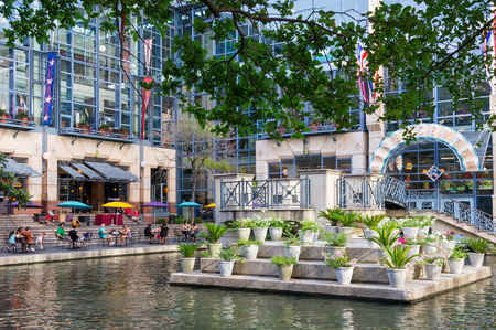 hosts: SAN ANTONIO, TEXAS:  JULY 25: River Center Lagoon on the River Walk on JULY 25, 2011. The Alamo City hosts some 32.5 milllion visitors per year. Editorial