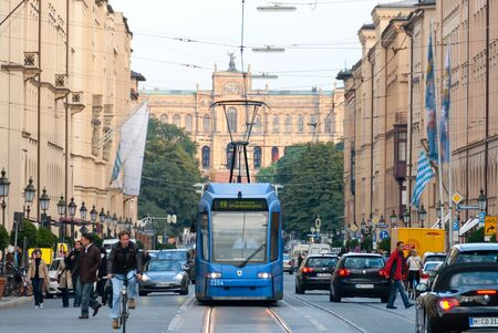 streetcar: MUNICH, GERMANY-SEP 19 - Maximilianstrasse, Streetcar, and a view of the Bavarian Parliment III on SEP 19, 2008. The street has the distinction of the highest retail rents in Germany.