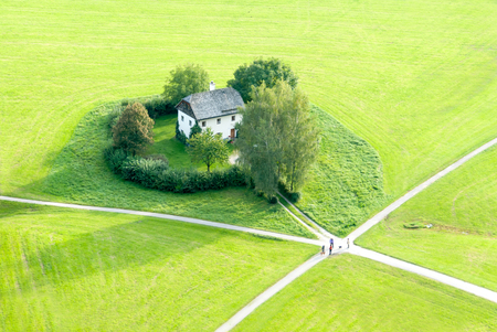 accidental: Meeting of friends at dissecting paths in an emerald green field Stock Photo
