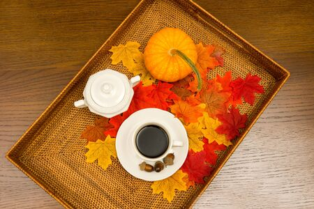 Coffee Cup, Sugar Bowl, Pumpkin, and Leaves Herald the Coming of Autumn VI Stock Photo