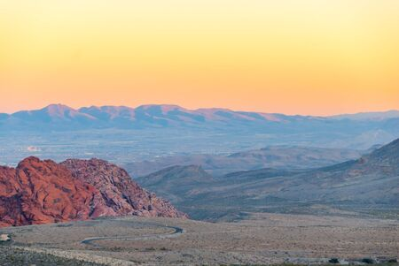 Red Rock Canyon at Dusk with Las Vegas Valley in the distance.